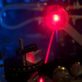 <span class=heading><b>Tunable solid-state lasers</b> by Alan Paterson</span><br />The image shows part of a typical solid-state laser cavity involving a prism to disperse the light. This research aims to put micro-devices into solid-state lasers to tune the nature of the outgoing beam of light. Such devices are smaller and cheaper than conventional methods and can be designed to perform any desired function.<br /><span class=small>Image: © 2016 Alan Paterson</span>.  <span class=small>Collaborators: Dr. Ralf Bauer (assisting), Dr. David Wilson (assisting) and Mr. Graham Wilson (photographer)</span>