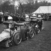 <span class=heading><b>Disability and Community </b> by Angela Turner (History)</span><br />The image shows paraplegic archers in a contest at the Miners' Gala Day in Newtongrange, 1960s. This illustrates key aspects of a current Wellcome Trust funded project at The University of Strathclyde concerned with Disability and Industrialisation. Coal mining was one of the most dangerous occupations in the 20th century with high levels of industrial injury and disease. Research has revealed strong community networks and how mining communities sought to mediate the impact of disability on miners and their families.<br /><span class=small>Image: © 2014 Angela Turner</span>