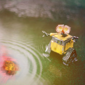 <span class=heading><b>When you see it...</b> by Mewantha Aurelio Kaluthantrige Don</span><br />The robot watches with dismay as an asteroid crashes into Earth, yet we can only see an unclear reflection of the event unfolding in the puddle. Unfortunately, current spacecraft technologies are not able to identify asteroids fast enough due to optical distortions. With the support of the European Space Agency, we are developing Artificial Intelligent algorithms for spacecraft systems to efficiently and precisely determine these threatening bodies.<br /><span class=small>Image: © 2021 Mewantha Aurelio Kaluthantrige Don</span>