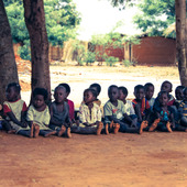 "<div><div style=""float:left;padding-left:5px;width:70%""><span class=heading><b>Tithandizane Orphan Care Centre </b> by Magnus Currie (Electronic and Electrical Engineering)</span><br />Orphans in rural Malawi wait patiently whilst University of Strathclyde researchers meet with the Village Chief and local women who look after the orphans.  