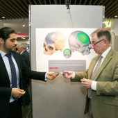 <span class=heading><b>Images of Research</b> by Guy Hinks</span><br /><p class=int>Winner of Innovation category, Mohammad Salamati, shows Professor Sir Jim McDonald the cranium implant used in his image.</p><span class=small>Image: &copy; 2018 Guy Hinks 2015</span>