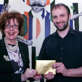 """<span class=heading><b>Drygate Brewery</b> by Guy Hinks</span><br /><p class=int>Bailie Liz Cameron presenting prize to Declan Bryans for his image """"Fully Harnessing Renewable Energy"""".</p><span class=small>Image: &copy; 2018 Guy Hinks 2015</span>"""
