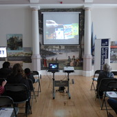 <span class=heading><b>Images of Research</b> by Rachel Clark</span><br /><p class=int>Our audience enjoying a short video about the Images of Research Competition.</p><span class=small>Image: &copy; 2017 Rachel Clark</span>