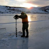 <span class=heading><b>Augers well.......</b> by Keith Torrance (Civil & Environmental Engineering)</span><br />Surface water quality shows significant temporal variation and must be sampled in all seasons. Reaching water during the Alaskan winter is a challenge when rivers are under several feet of ice. Fortunately, ice fishers have already solved this problem using motorised ice augers to make short work of drilling through the ice. This photo was taken near Iliamna, Alaska, in January 2013. <br /><span class=small>Image: &copy; 2013 Keith Torrance</span>